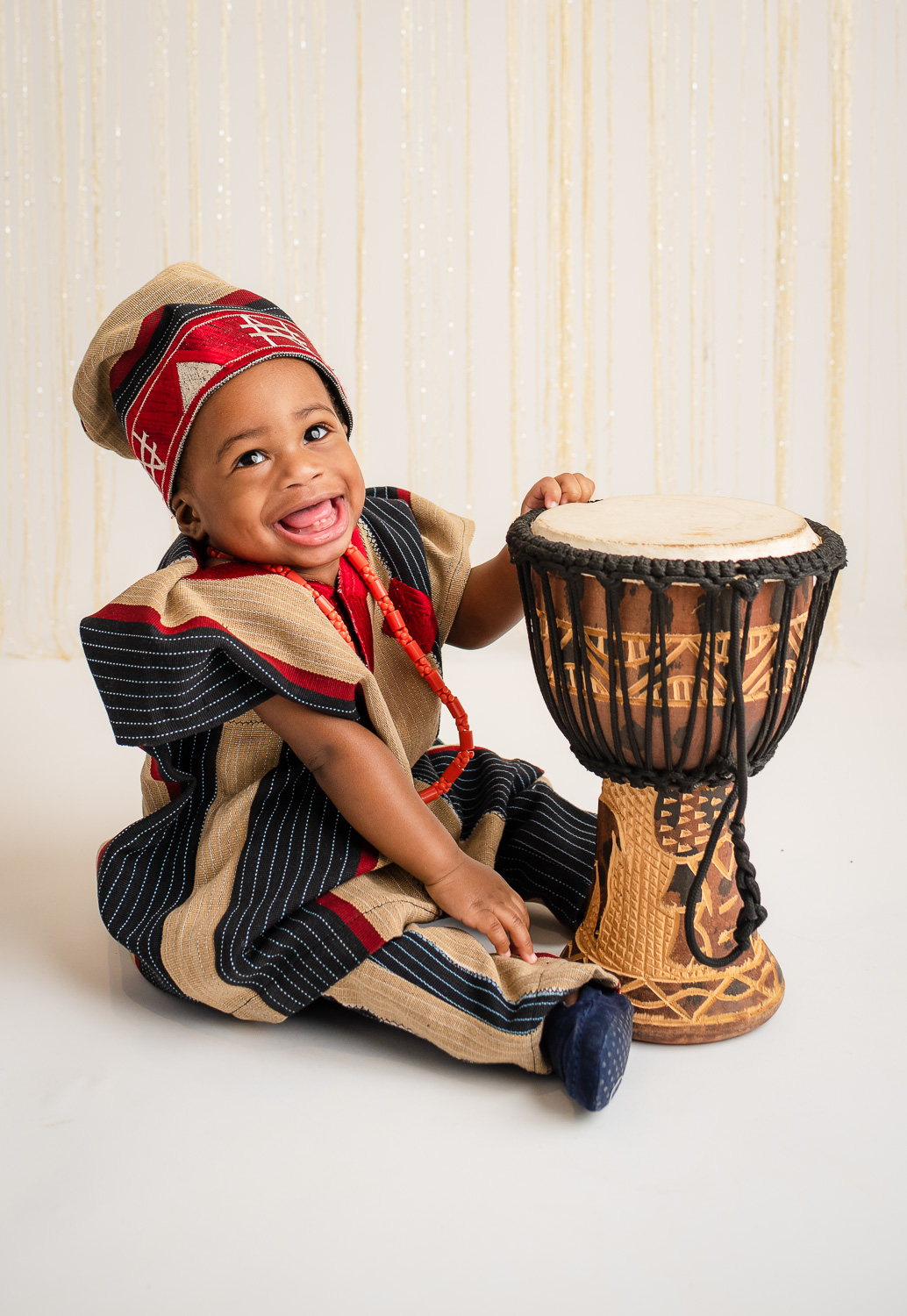 baby playing on a drum
