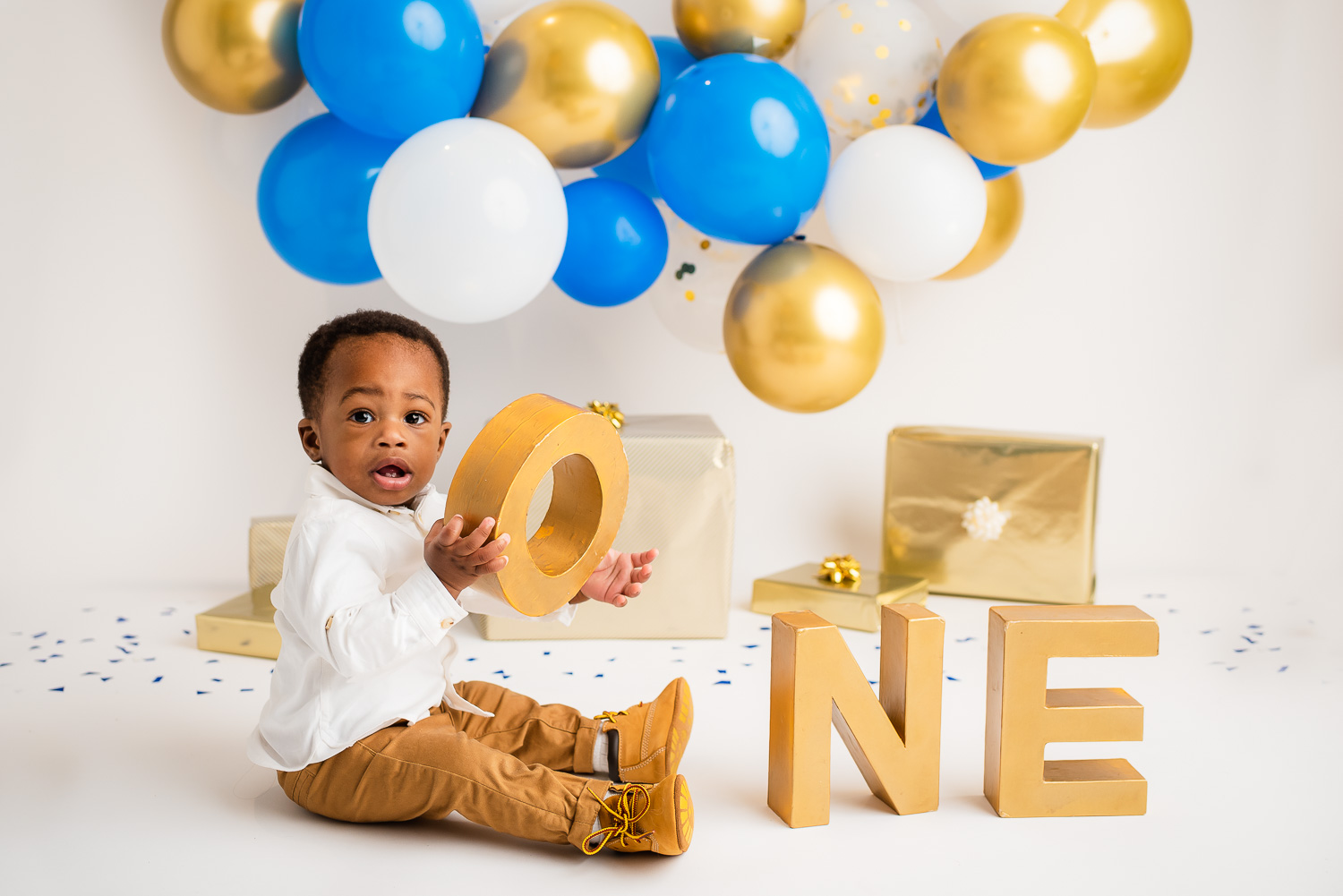 baby holding a sign ONE
