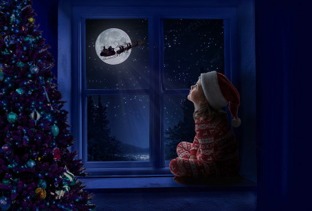 SANTA FLYING OVER THE MOON